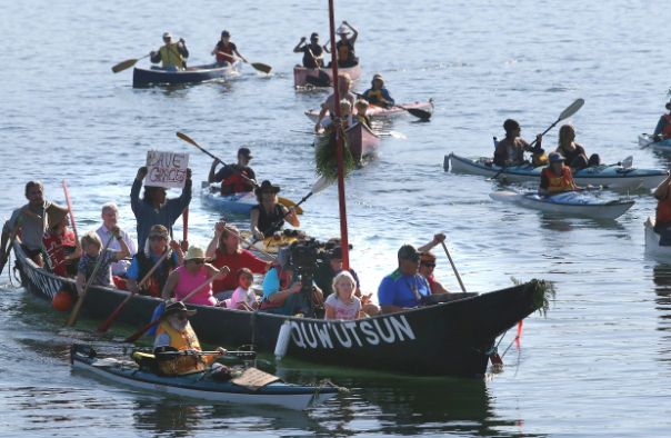Saltspring Island residents together with First Nations elders took to the water Tuesday to demand a halt to the construction of a luxury home on Grace Islet, in Ganges Harbour.